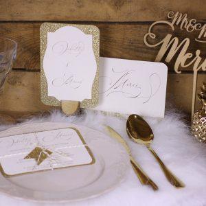 mise en scène avec assiette, doré, paillette, spiritus naturae, menu, faire part mariage